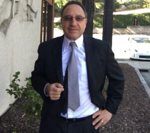 Criminal Defense specialist and trial lawyer daniel Horowitz in suit outside law office of daniel horowitz lafayette ca Dan horowitz is wearing a suit, white shirt and grey tie, dark glasses tinted brown with the office building in lafayette in the background with some trees and a parking lot