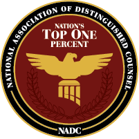 image is a circle with an eagle and a reference to Membership as Nations top 1 percent lawyers awarded by the national association of distinguished counsel.