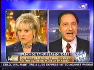 "Physician Defense lawyer Daniel Horowitz shown on television with host ""Nancy Grace"" on the ""Nancy Grace Show"" . the caption is ""Jackson Molestation Case"" where horowitz and grace debate opening statements"