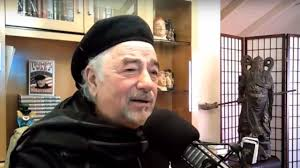 photo of savage nation radio show host Michael savage at home studio with beret